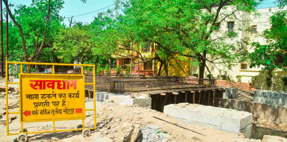 Noida Authority starts covering drain outside Sec 39