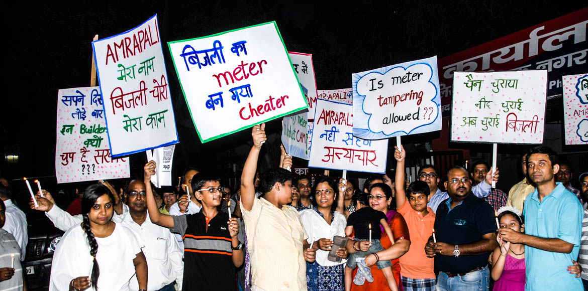 Candle march in Noida over inflated power bills