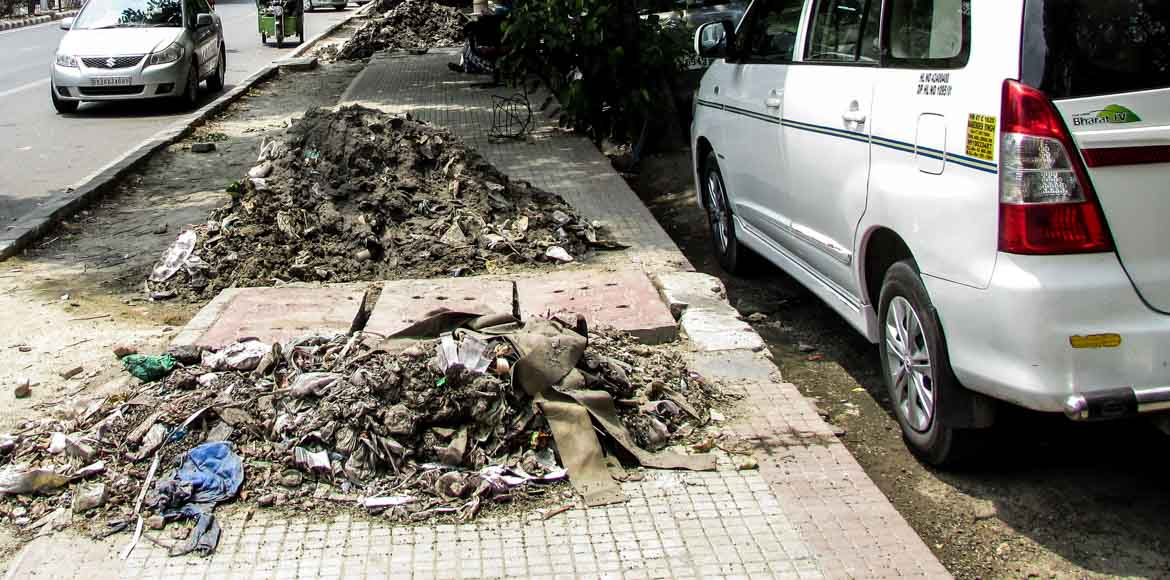 Civic apathy causes footpath spill in Dwarka