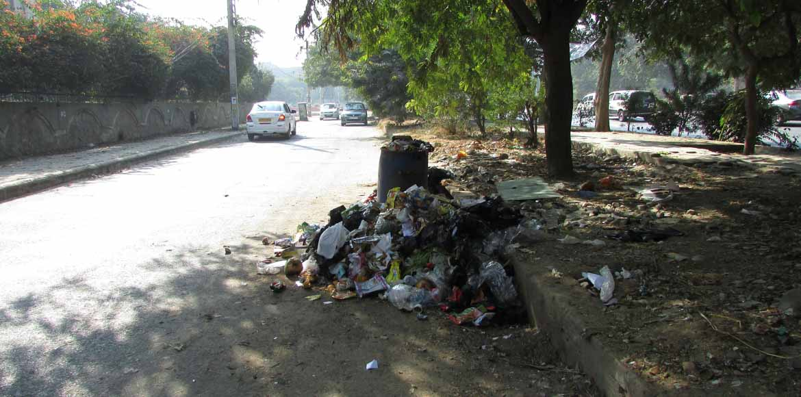 Garbage and open manholes a nuisance in Sector 7,