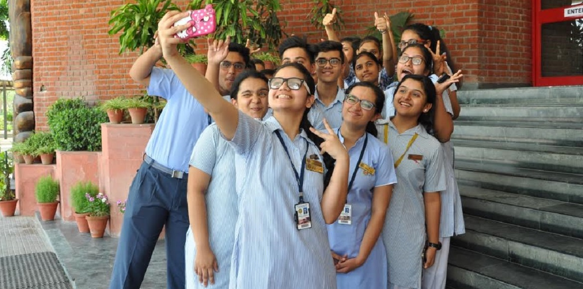 How many Amity International Class X students scored a perfect 10?