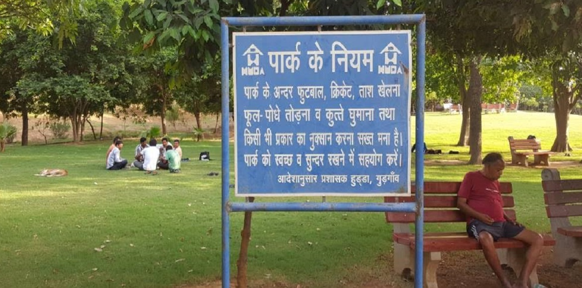 People play cards in this park despite this signboard. What's wrong with them?