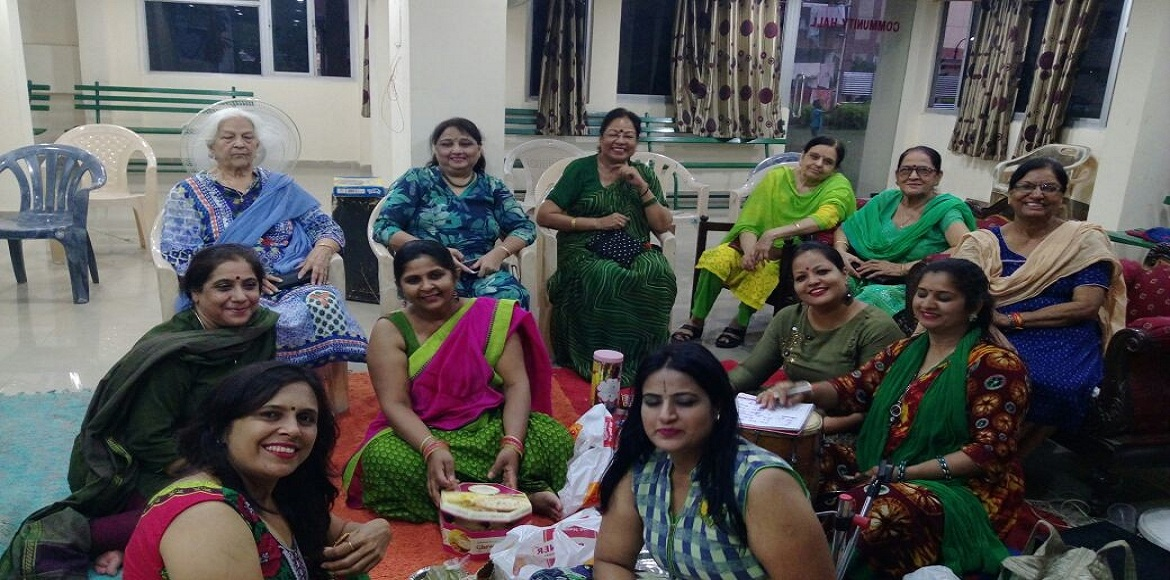 It was Teej, and the women of Ganpati Apts made the most of it