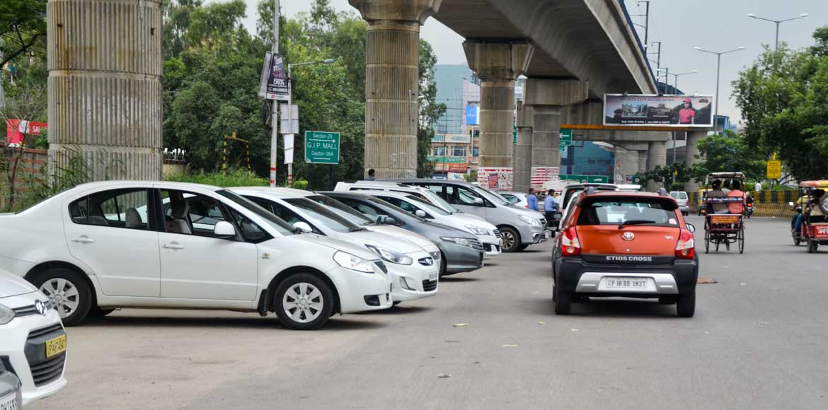 Noida: If you got a sticker on your car, you parked wrong!