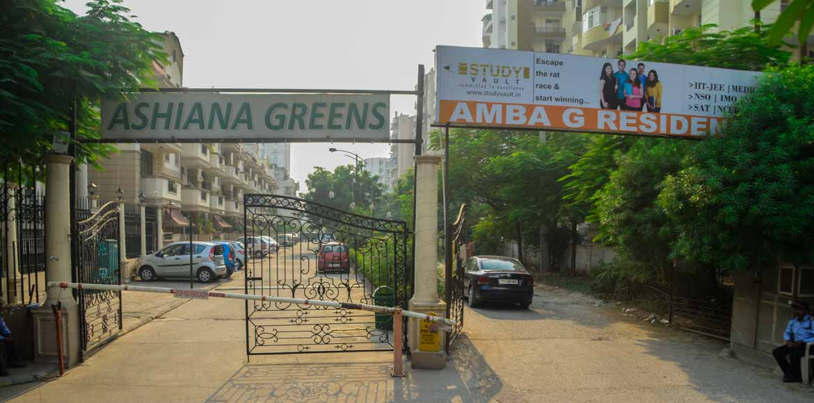 A public road for Amba G Residency and a private patio for Ashiana Greens?