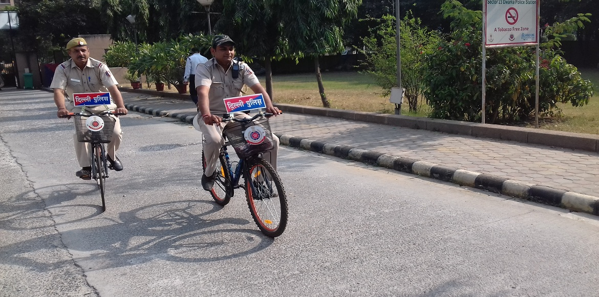 Policemen on bikes are orienting Dwarkaites on security issues