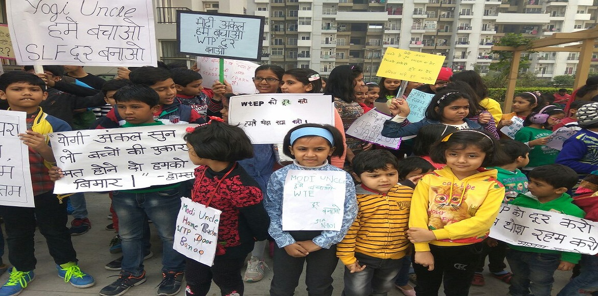 Now children in Noida launch protest against garbage dump yard in their locality