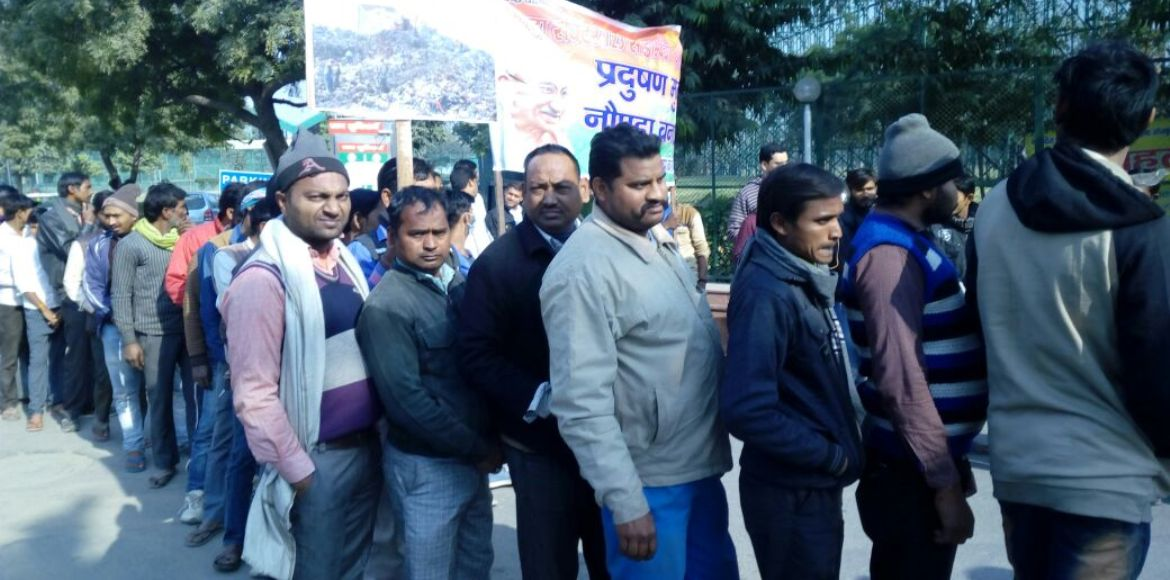Residents go on a march against the Sector 123 dumpsite in Noida