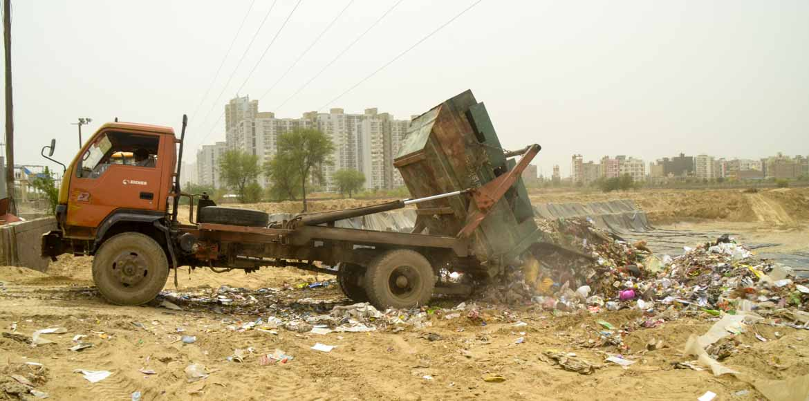 Noida Authority starts dumping of waste at Sector-123; livid residents protest