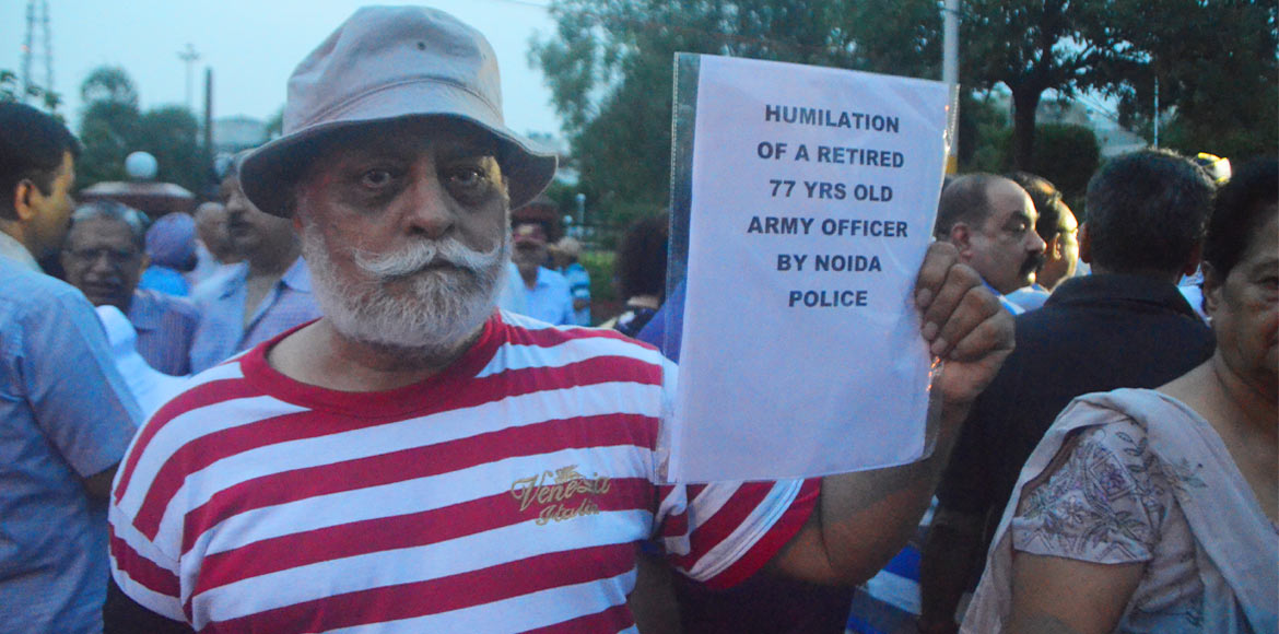 Counter FIR filed against ADM; army officers hold candle march to protest