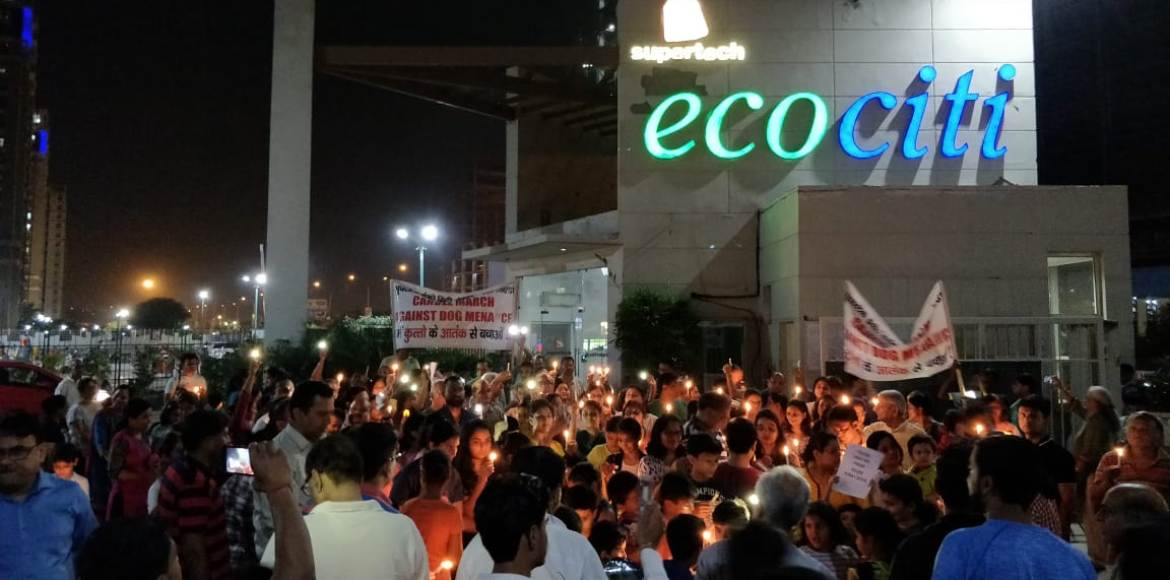 Supertech Ecociti residents in a candle march against dog menace in the basement