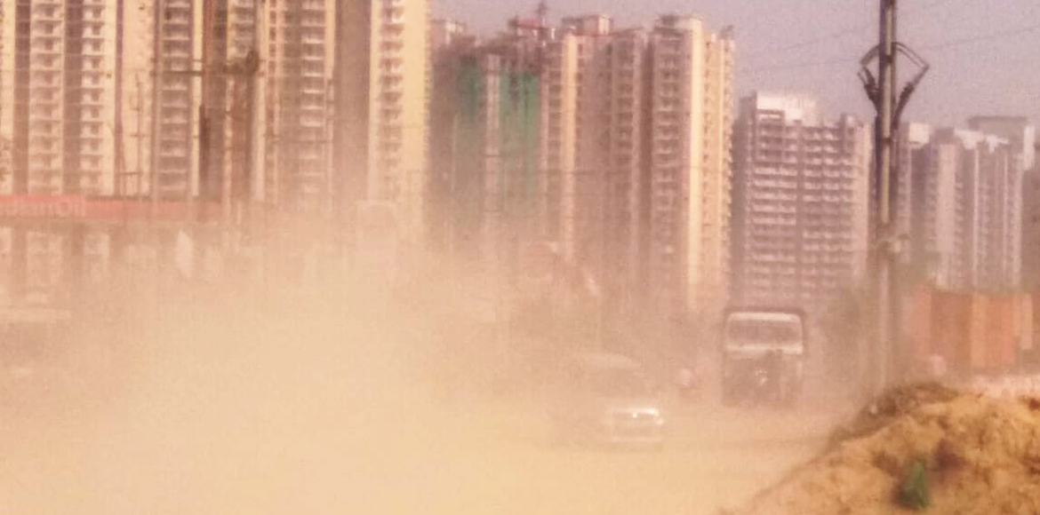 Dusty service lane turns a nightmare for Ecovillage 2 residents in GreNo