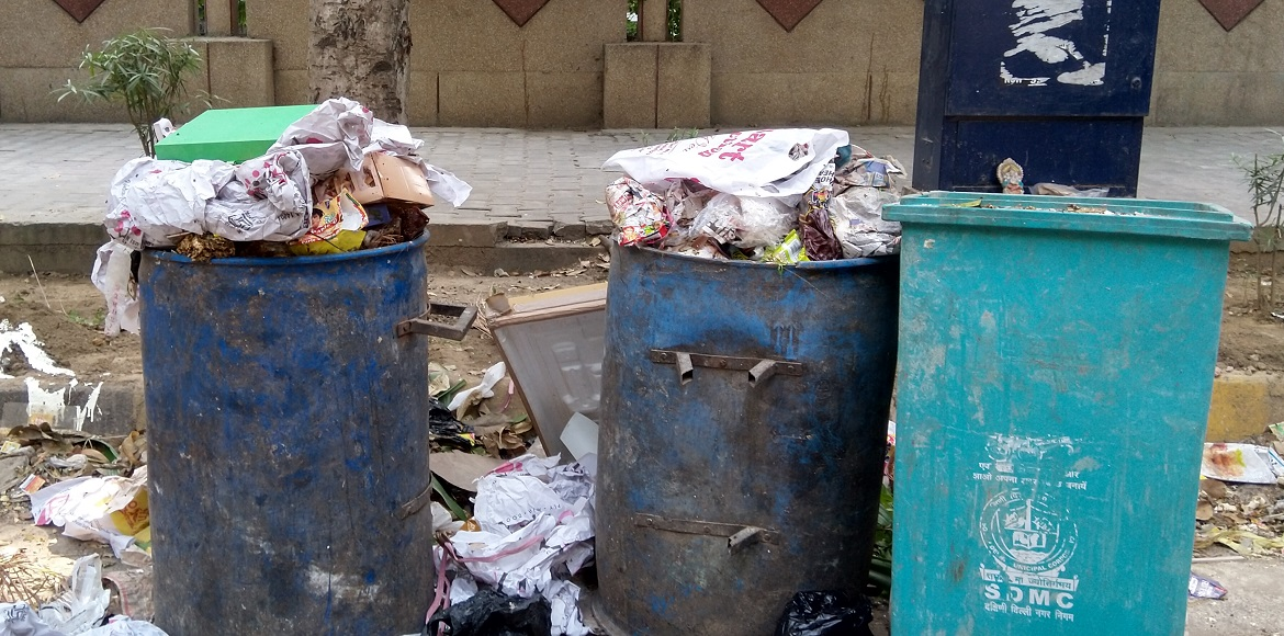 Overflowing dustbins become common sight in Dwarka