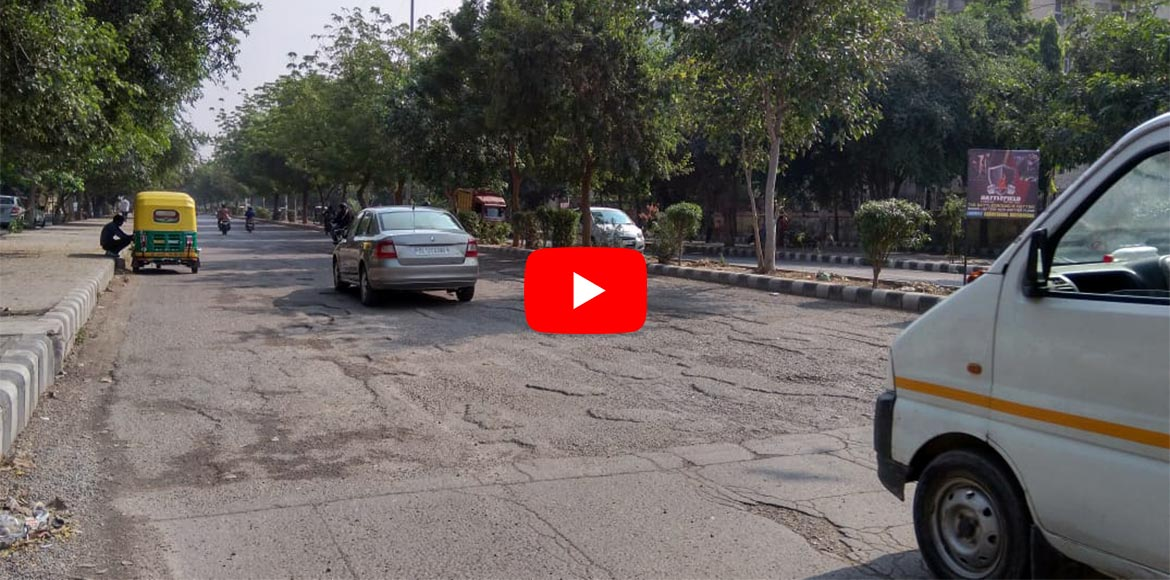 WATCH: Potholes at Ashoka Chowk pose threats to commuters in Dwarka