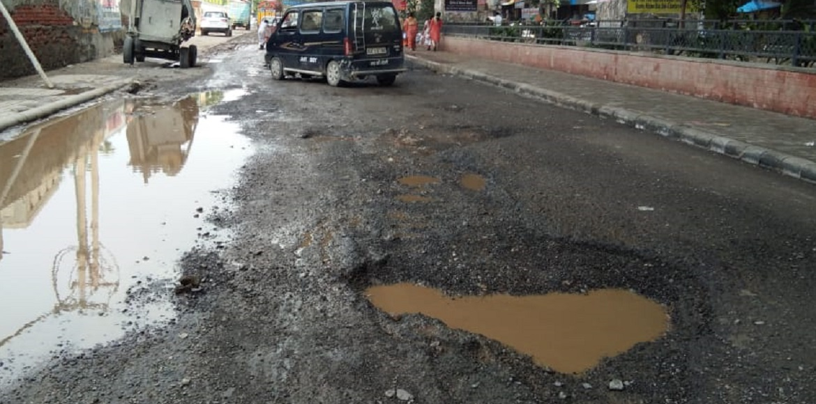 Dwarka: After rain, two-wheeler riders struggle with potholes on roads