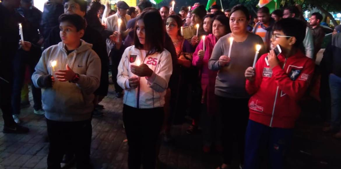 Dwarka carries out candle march for Pulwama martyrs