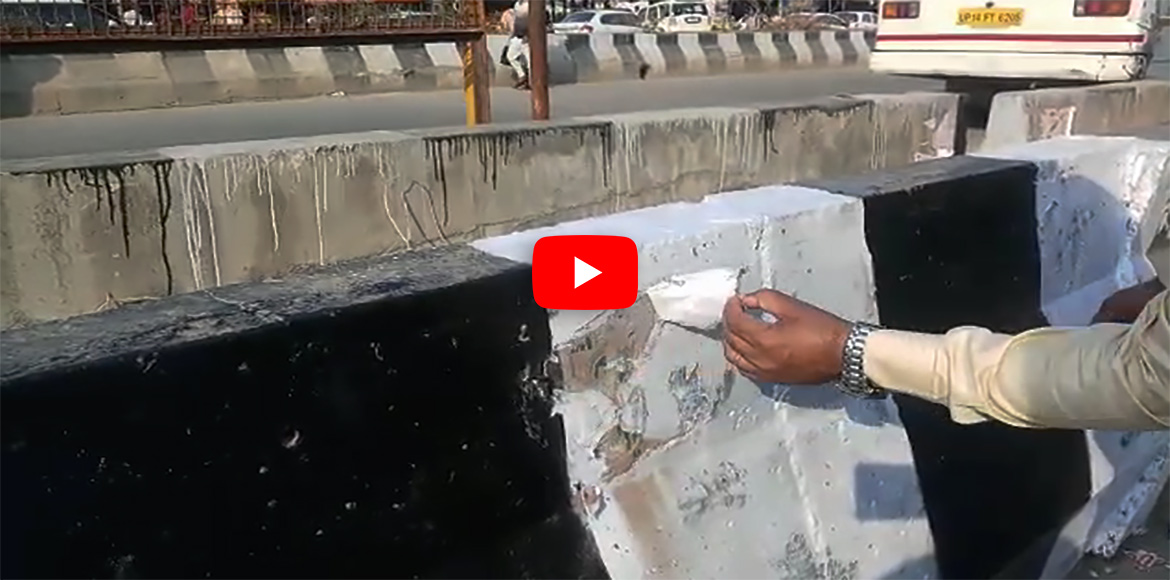 WATCH: Painting on divider continues without removing posters in GreNo
