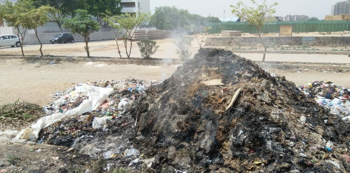 Waste burning near school in Sec 14 shows sad stat