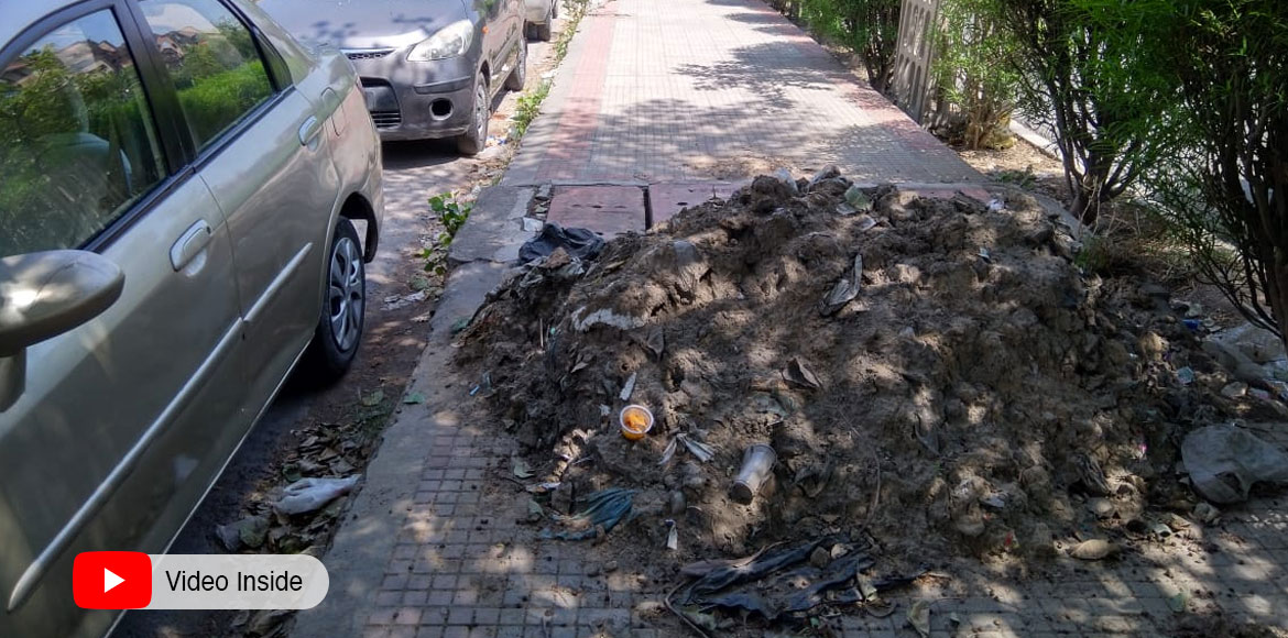 Dwarka: Dumped silt, open drains on footpath create mess for pedestrians