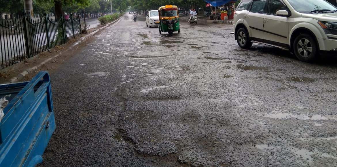 Bad roads, short spell of rain trouble commuters across Dwarka