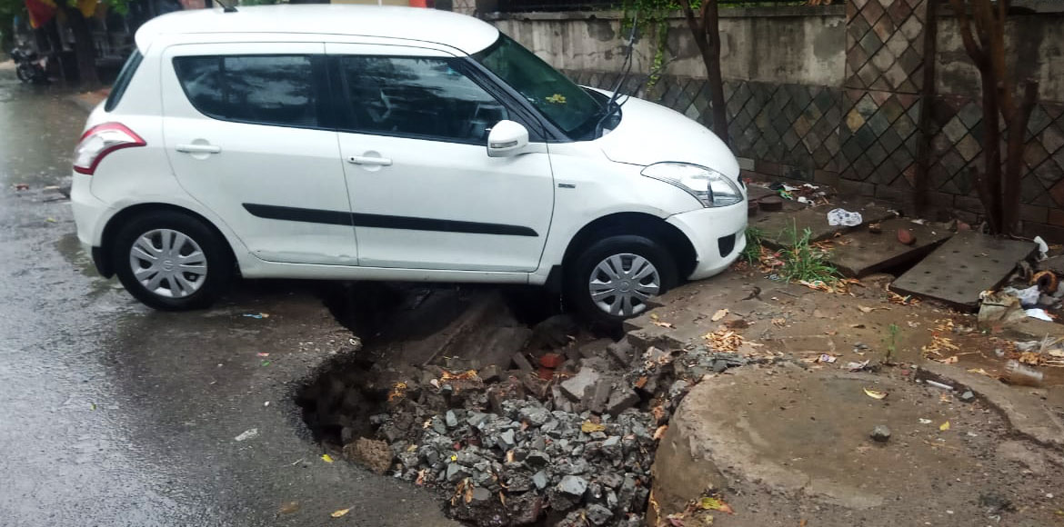 Noida: Soil below parked car washes away during first rain at Sec 50