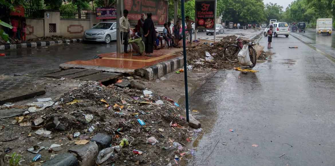 Dwarka: Heaps of silt dumped across footpaths affe