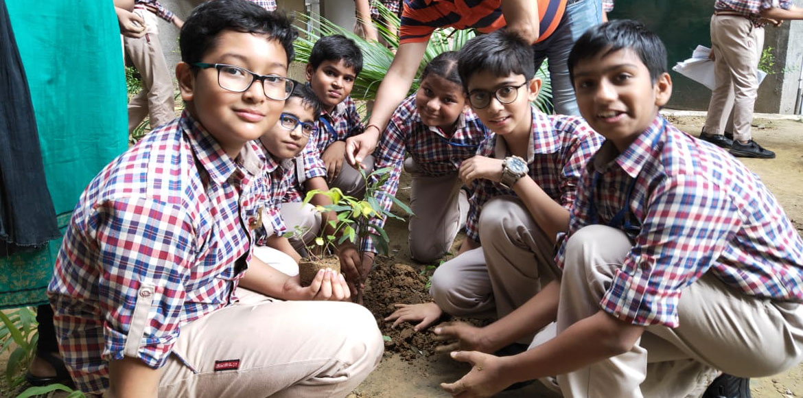 Dwarka: Heritage Tower Apartment, NK Bagrodia students planted trees