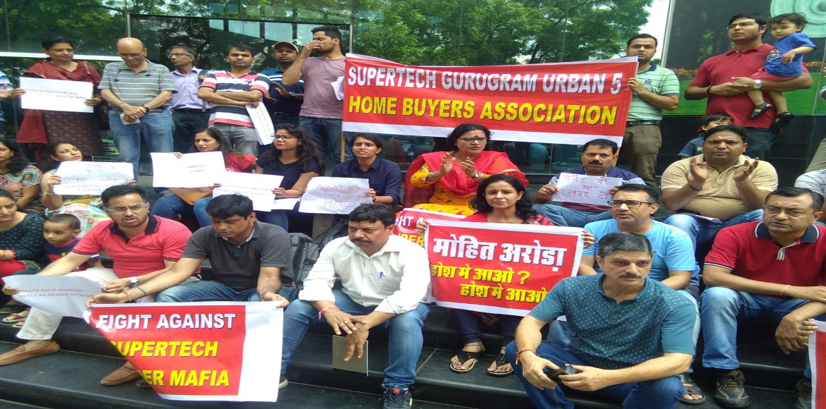 Homebuyers of two housing projects stage protest outside builder's office
