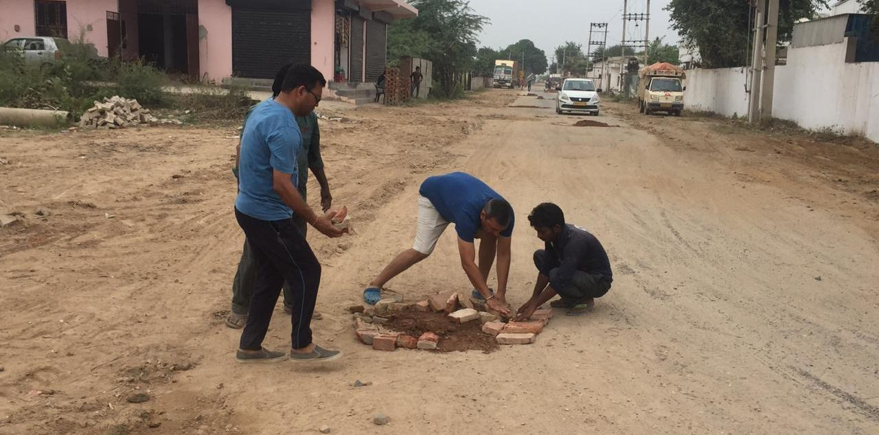 After authorities turn deaf ear, exasperated Vipul Lavanya residents repair road