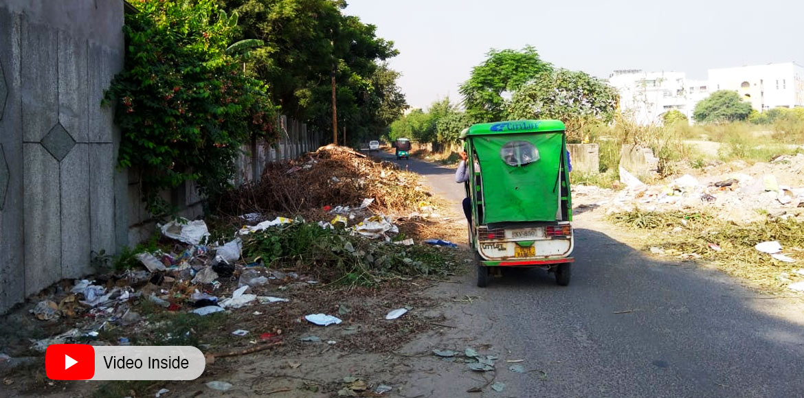 Dwarka: Rampant dumping, burning of waste at roadside in Sec 14