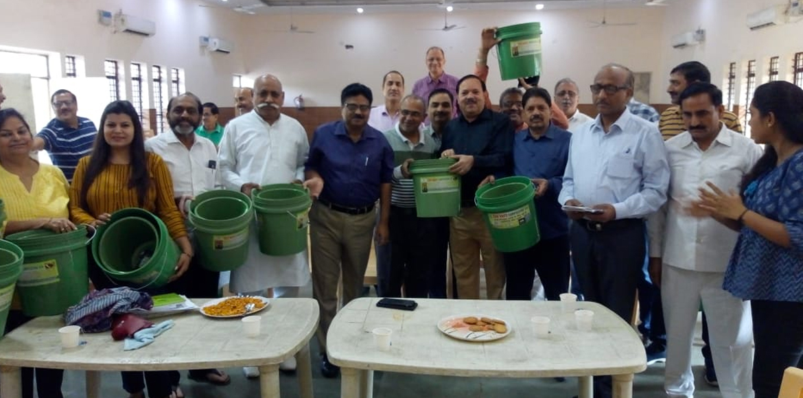 Noida Authority officials distribute cleaning kits