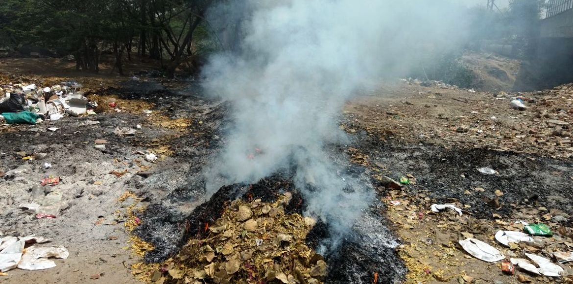 Garbage burns as civic authorities look the other way