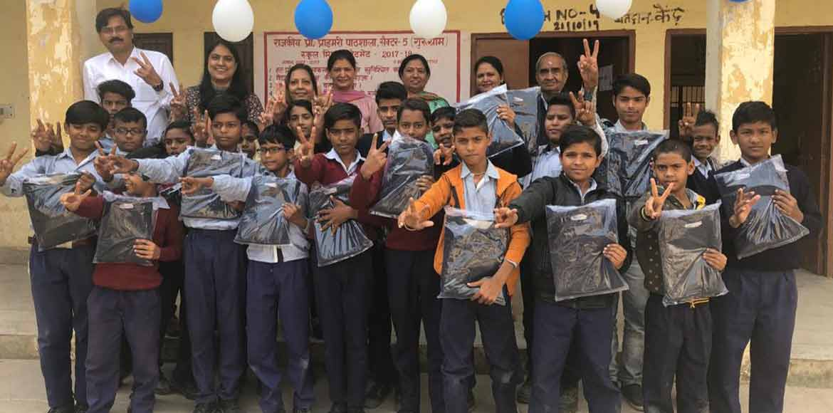 NGO distributes winter clothes among children at govt school