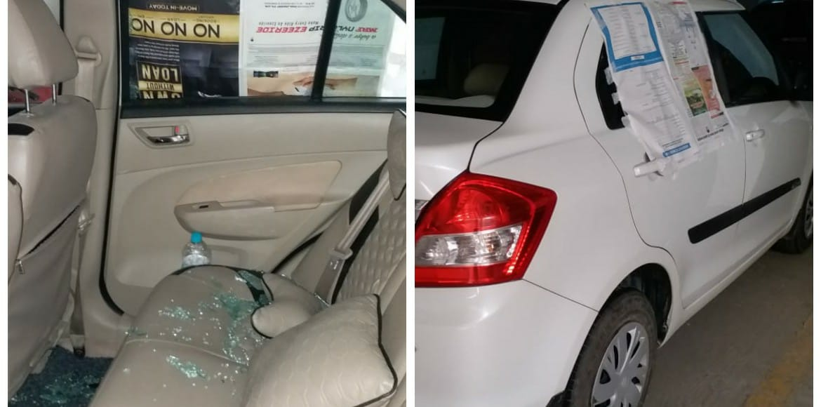 Parked for just 7 minutes, windowpane smashed; bag