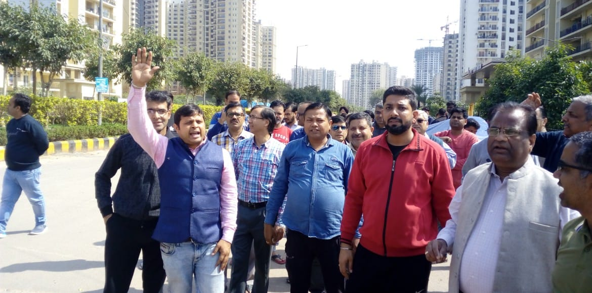 Residents of Sec 75 highrises march for development of incomplete projects