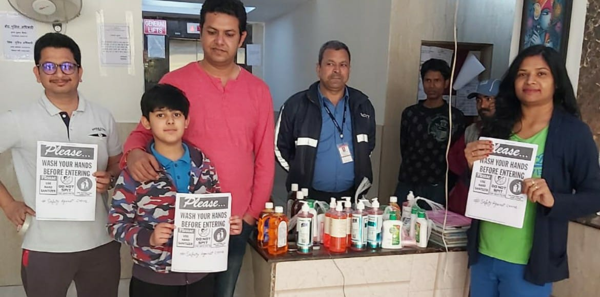 Residents of Gaur City 6th Avenue distribute hand sanitisers among guards