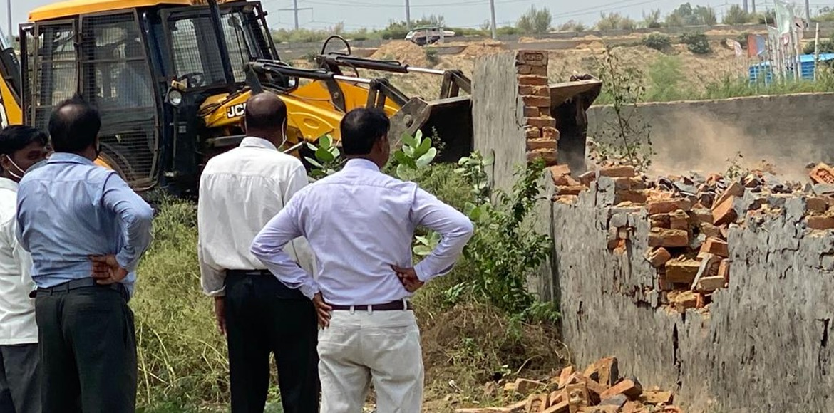 Noida Authority removes encroachment on 14,000 sqm of govt land