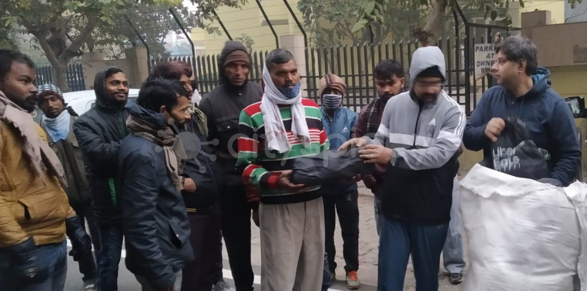 Noida: Warm jackets distributed among societies' support staff at Sec 61