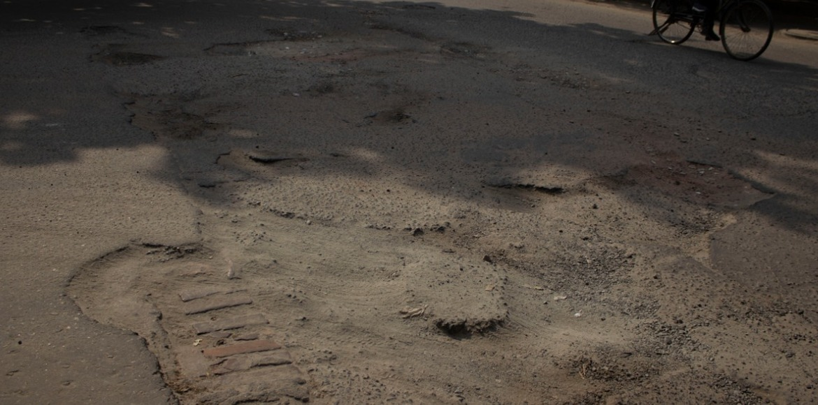 Potholes topple riders in Dwarka's Sector 10