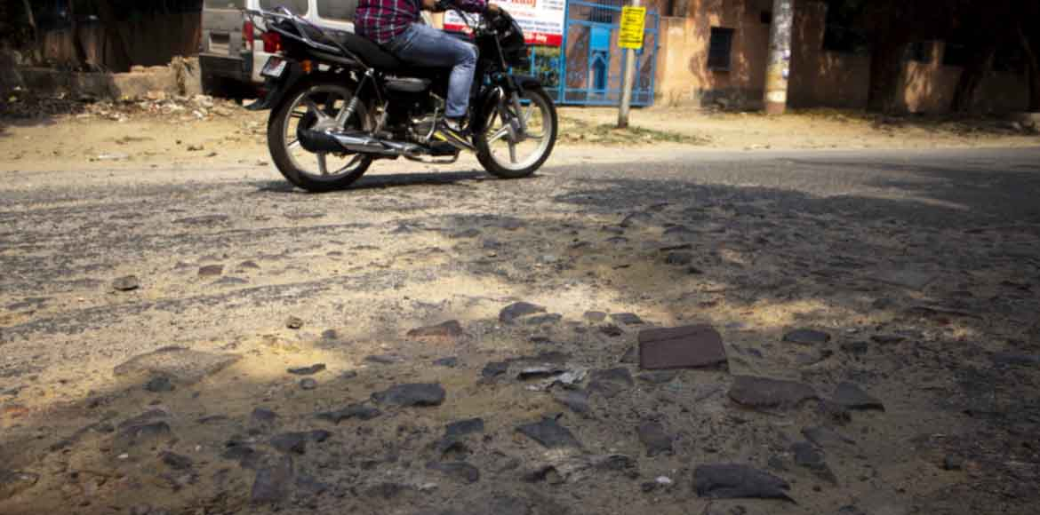 Tattered road makes life difficult for commuters in Dwarka