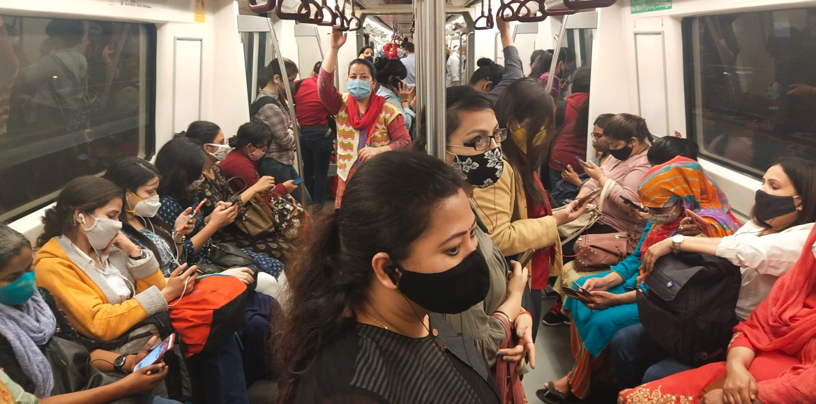Commuters continue to violate social distancing norms inside Delhi Metro