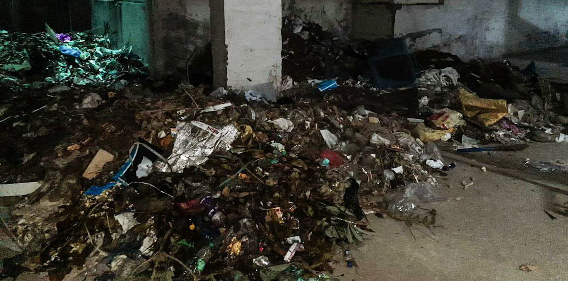 Gaur City 2: Garbage being dumped in basement of 10th Avenue