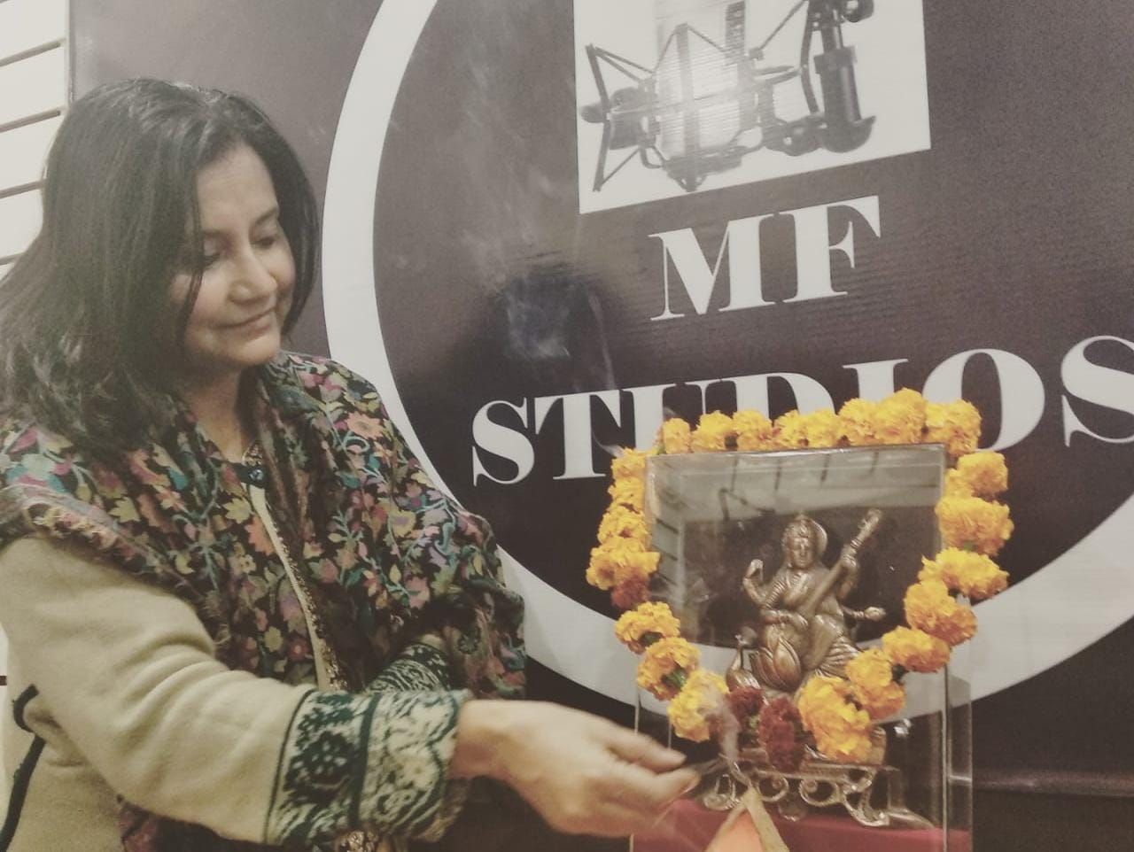 A singer from Dwarka, Madhumita Vishwas performing puja at her studio, Melody Foundation, Sector 22