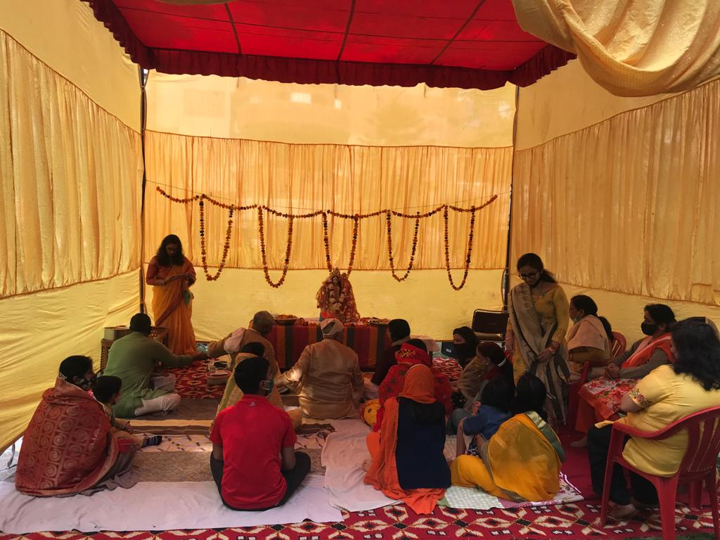 Rituals being performed at Krishna Apartments, Sector 9 on the occasion of Saraswati Puja