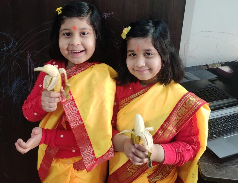 Twin sisters Adya and Arya in Saree with banana as prasad after puja