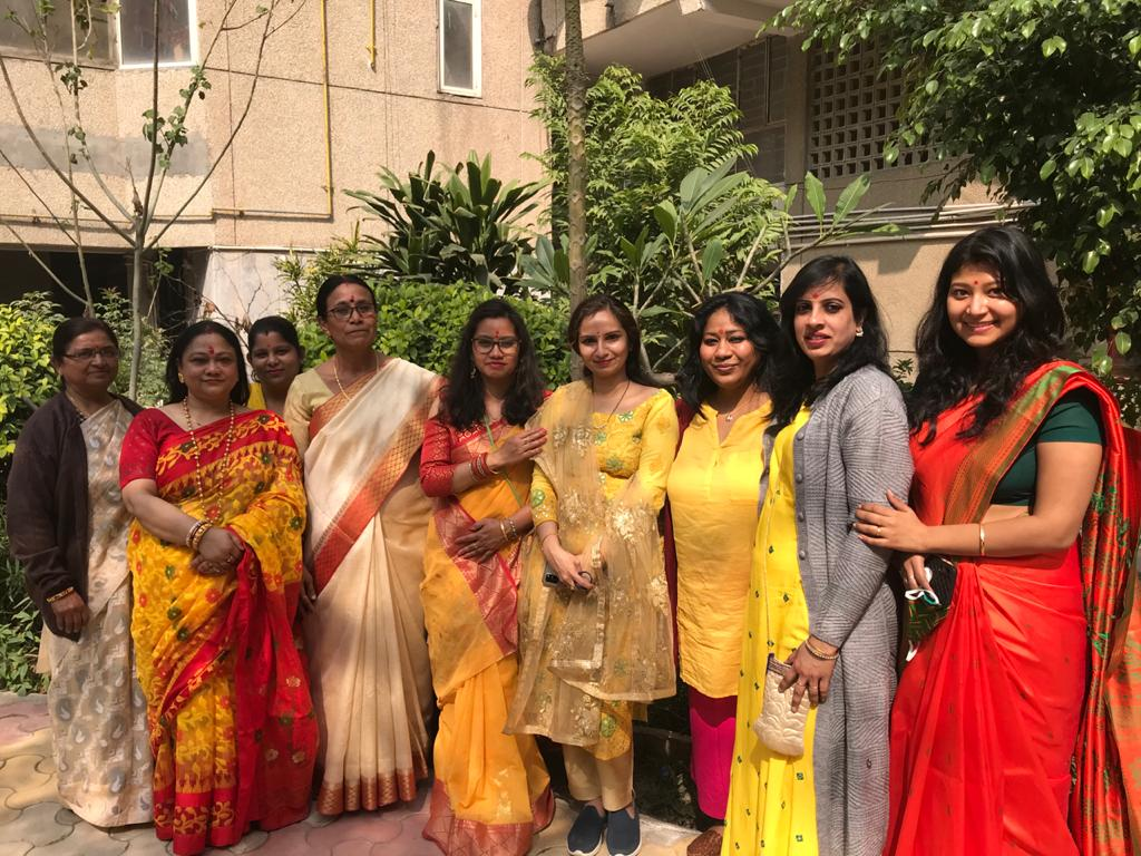 Women in happy mood at Krishna Apartments, Sector 9 posing for a group photo
